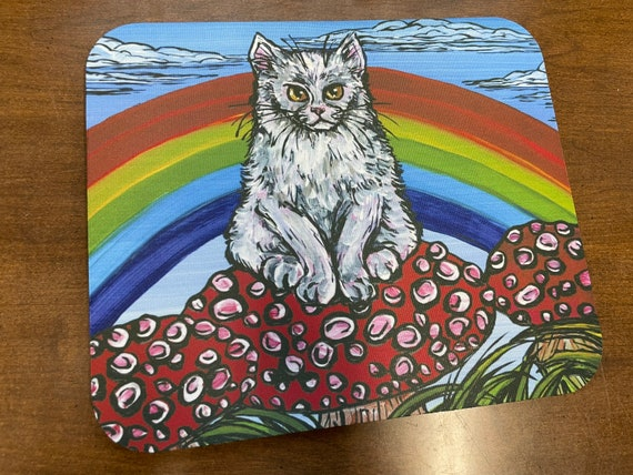 Grouchy White Cat with Rainbow mousepad featuring artwork by Tracy Levesque