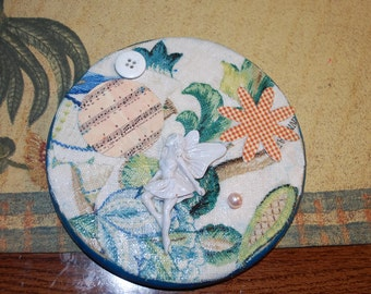 Decoupage Collage Box with blue fabric and trinkets and stickers