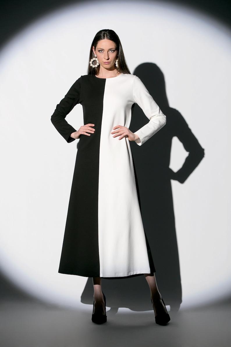 007854f37d2a Metà nero metà bianco una linea di abito con manica lunga