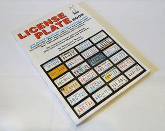 License Plate Book Paperback –  by Thomson C. Murray (1992)