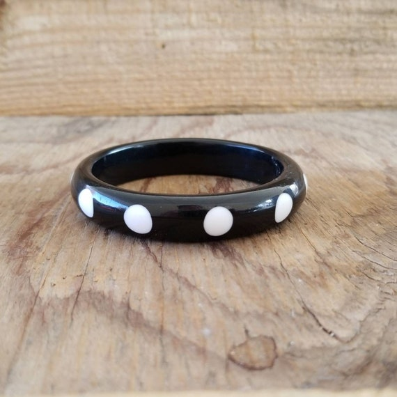 Vintage 1980s unused moulded bone white black lucite plastic bangle bracelet with polka dot decor