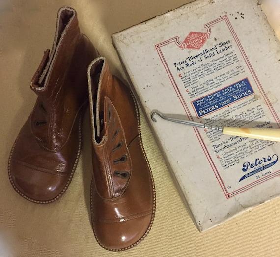 "1920s ""Peter's Weatherbird Diamond Brand"" shoes"