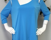 New Plus size tunic with details to the neckline and shoulders.Asymmetrical bottom.