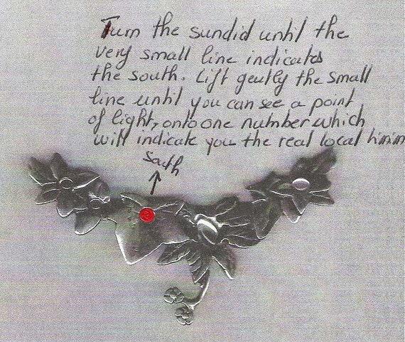 Collier fleurs cadran solaire feuille pendentif