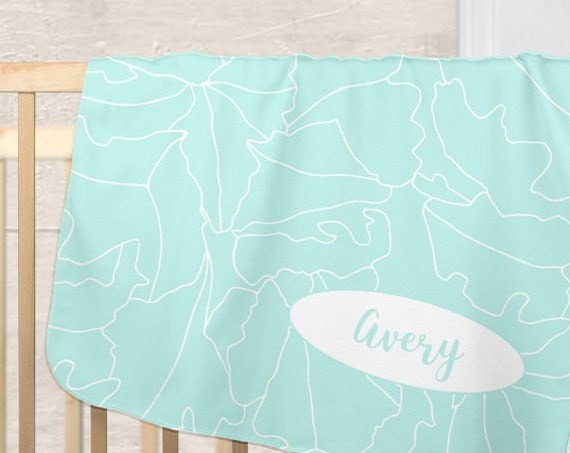 Contemporary Aqua Blanket for Baby with Personalized Name and Tropical Leaf Motif