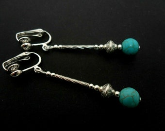 A PAIR SILVER PLATED  DANGLY  CLIP ON TURQUOISE BEAD EARRINGS NEW.