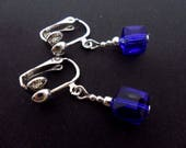 A pair of cute little hand made tibetan silver dangly cobalt blue crystal cube bead clip on earrings. new.