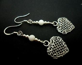 A pair of pretty tibetan silver /& pink jade  bead heart themed dangly earrings.