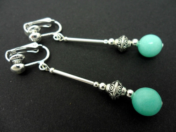A PAIR OF DANGLY BLUE JADE BEAD  SILVER PLATED DROP CLIP ON EARRINGS.