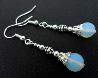 A pair of pretty dangly opalite  bead  dangly earrings.