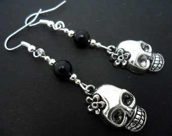 A pair of tibetan silver skull flower dangly earrings.