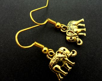 A pair of cute little dangly gold colour elephant  themed  earrings.