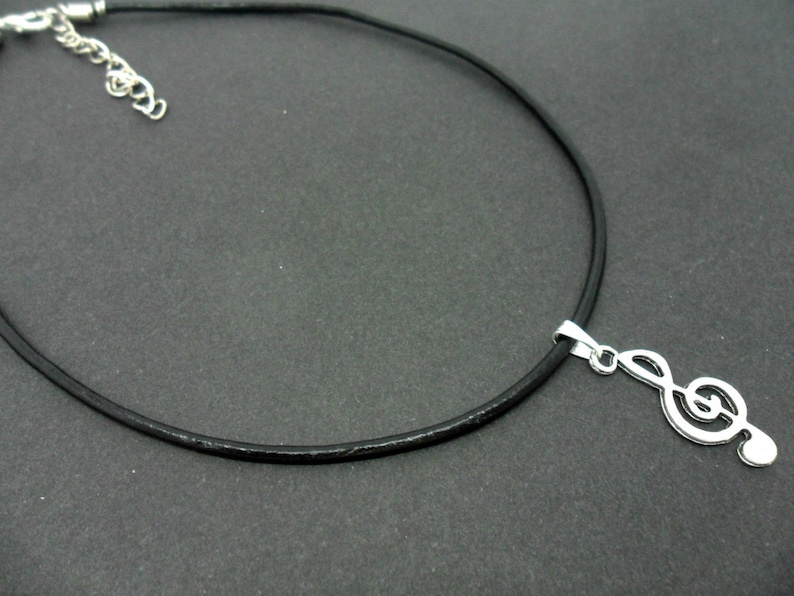 A leather cord 13-14 tibetan silver treble clef musical note charm choker necklace.