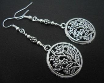 A pair of pretty tibetan silver circle flower   dangly earrings.