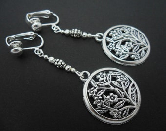 A pair of pretty tibetan silver circle flower   dangly clip on earrings.