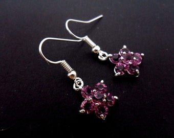 A pair of pretty hand made purple crystal flower dangly earrings. new.