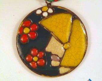 Round ceramic pendant in lava stone