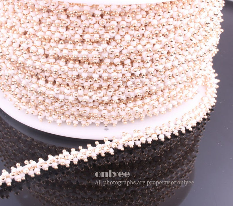 N121G 3FT - Chain Multe Lacy White Seed Glass Bead Gold Plated over Brass  7.6mm 1yd