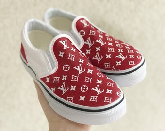 7bd44b00903 supreme x lv slip on vans