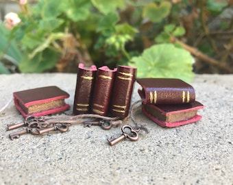 Deep Red Leather Book with Copper Colored Key - Dollhouse Miniatures