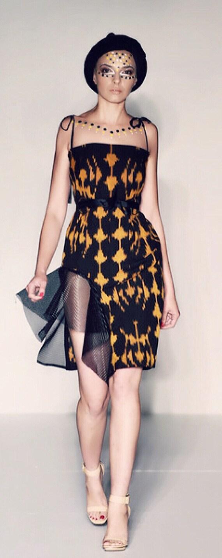 Ikat dress with net side ruffle.