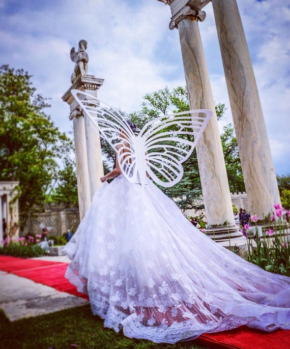 "Irina Shabayeva white ""Butterfly"" wings."