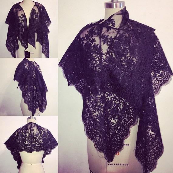 Irina Shabayeva black lace capelet wrap with scalloped edges .