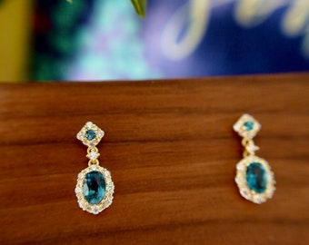 Blue Topaz Earrings // Halo Setting // Dangling Style // Cubic Zirconia // 14K Yellow Gold Plated Over Silver