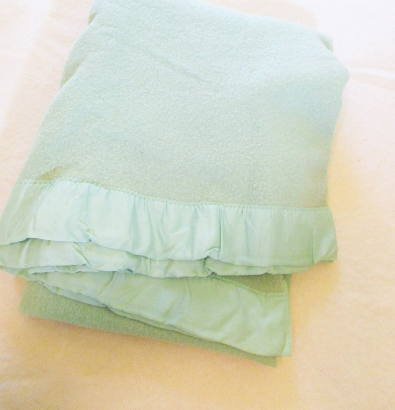 A Mint Green Wool Blanket With Satin Binding Soft Felted