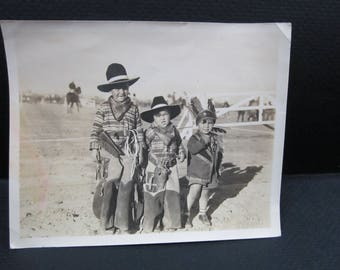 snapshot children playing cowboys and Indian