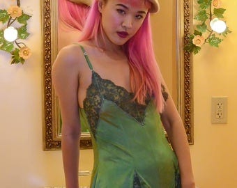 vintage 1970s hand dyed green romper with lace trim