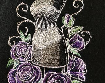 Machine embroidered panel title tailored