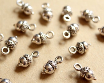 25 pc. Small Tibetan Style Antique Silver Plated Acorn Charms: 14mm by 7mm - | MIS-186