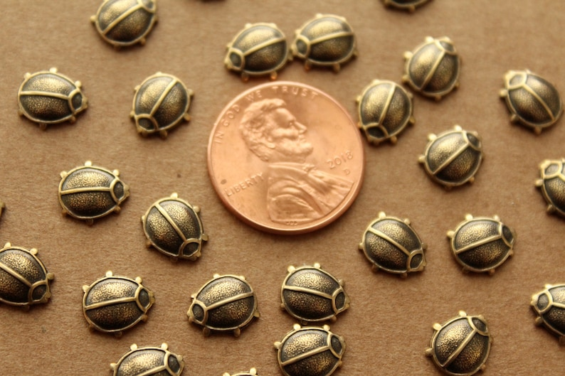 AB-129 8 pc made in USA Tiny Antique Brass Plated Beetles: 8.5mm by 8mm