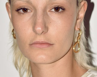 G77 mismatched earrings