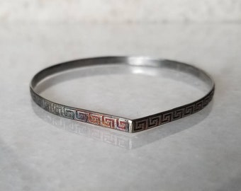 Petite sterling silver meander arch bangle