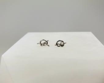 Tiny sterling silver knot studs