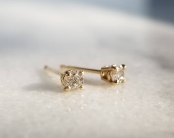 Sparkly 14k gold 3mm diamond stud earrings.