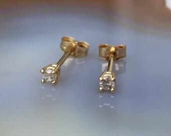Sweet 14k gold 2mm diamond studs  earrings.