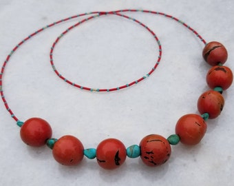Long, organic red tagua seeds and turquoise nuggets beaded layering necklace