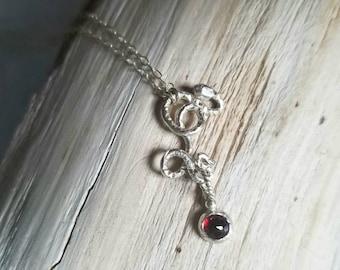 Handmade sterling silver snake pendant with rose cut garnet dangle, January birthstone