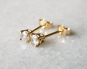 Sparkly 14k gold 3mm diamond studs  earrings.