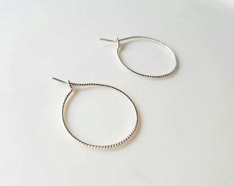 Delicate sterling silver twisted hoop earrings