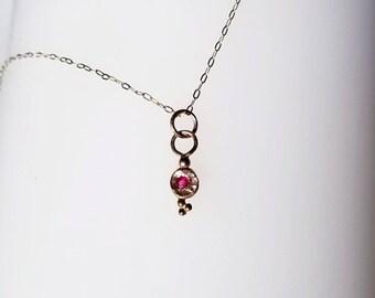 Unique 14k gold baby ruby tiny treasure pendant