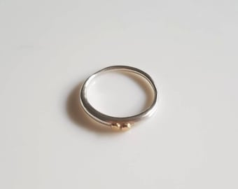 Sterling silver tapered band with 14k gold accents, size 7.25