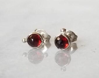 Deep red garnet sterling silver sister orbit stud earrings