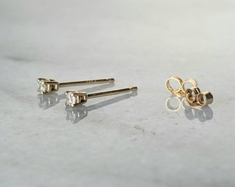 Petite 14k gold 2mm genuine conflict free diamond studs, salt and pepper post earrings.