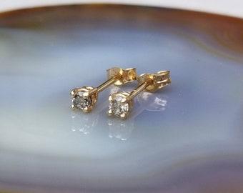 Sweet 14k gold 2.5mm diamond studs  earrings.