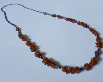 Long, beaded asymetrical necklace with Baltic amber and lapis lazuli