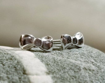 Tiny sterling silver bow stud earrings